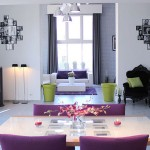 http://www.iidudu.com/contemporary-white-home-with-cute-colorful-interior-design/purple-chairs-with-wooden-table-and-pink-flowers-in-dining-room/